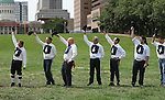 """Lafayette Cyclone BBC (base ball club) players tip their caps and yell """"Huzzah"""" as part of their tribute to the Belleville Stags following their Saturday August 18 game under the Gateway Arch on the St. Louis riverfront."""