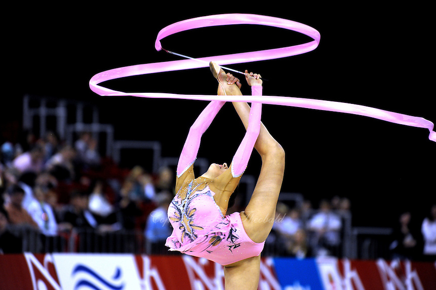 Evgeniya Kanaeva of Russia pirouettes with ribbon at 2009 Budapest World Cup on March 7, 2009 at Budapest, Hungary.  Photo by Tom Theobald.