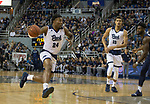 Nevada's Jordan Caroline (24) drives against Akron in the first half of an NCAA college basketball game in Reno, Nev., Saturday, Dec. 22, 2018. (AP Photo/Tom R. Smedes)