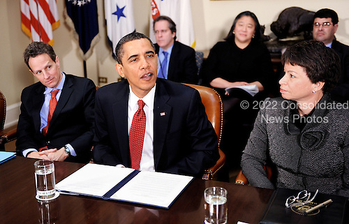 Washington, DC - December 22, 2009 -- United States President Barack Obama flanked by Timothy Geithner, Secretary of the Treasury and Valerie Jarrett , senior advisor and assistant to the president attends a meeting with CEOs of several small and community banks in the Roosevelt Room at the White House, in Washington, DC, on Tuesday, December 22, 2009. .Credit: Olivier Douliery / Pool via CNP
