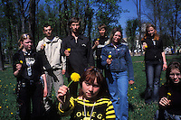 BARANAVICHY, BELARUS - MAY 5: Pro-democracy university students, including Dasha Miroshnichenko, 15, (foreground center) gather for a group portrait in a public park on May 5, 2004 in Baranavichy, Belarus. For years, Belarus was frozen in its communist past. Now the radical change that has swept the former Soviet Union -- from Georgia's 2003 popular uprising to Ukraine's orange revolution last winter to the recent meltdown in Kyrgyzstan -- is catching up with President Alexander Lukashenko, a dictator whose regime has been described as Stalinism minus the Gulag. The images here capture a country and a people inexorably moving toward revolution: Student activists organizing illegally, democratic reformers meeting in rusting warehouses, protesters holding pictures of 'enemies of the state' murdered by the security services. Just beneath the apparent ordinariness and staidness of this post-Soviet republic, which is barely distinguishable from its former Soviet self, is a deep and powerful anger and a yearning for a new politics and a new possibility. That is the crux of Belarus today -- anger and yearning held together by the glimmer of a hope that tomorrow the regime may tumble. (Photo by Landon Nordeman)