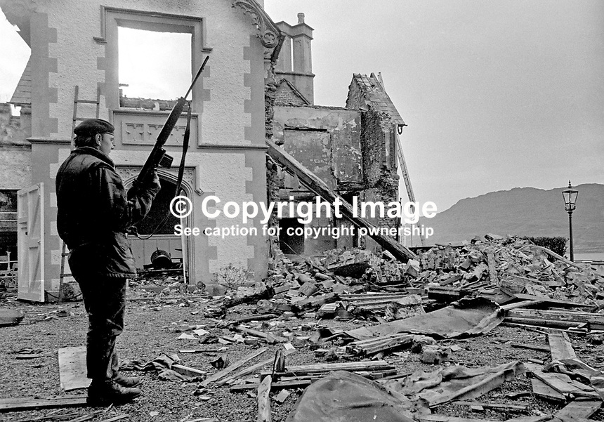 A soldier on duty at the burnt-out remains of the home of Major Ivan Neill at Rostrevor, Co Down, N Ireland, UK. The December 1971 fire was a result of an arson attack by the Official IRA who had a few months earlier failed to kidnap Major Neill from his home. Major Neill is the Speaker of the N Ireland Parliament at Stormont. 197112300554a.<br />