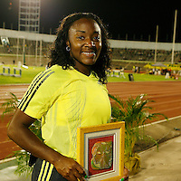 Bianca Knight is all smiles with her award after finishing 2nd. in the 200m with a time of 23.15sec. at the Jamaica International Invitational Meet on Saturday, May 2nd. 2009. Photo by Errol Anderson, The Sporting Image.net