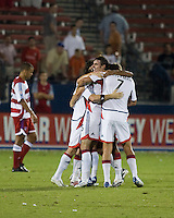 New England Revolution players celebrate.  New England Revolution defeated FC Dallas 3-2 to capture the 2007 Lamar Hunt U.S. Open Cup at Pizza Hut Park in Frisco, TX on October 3, 2007.