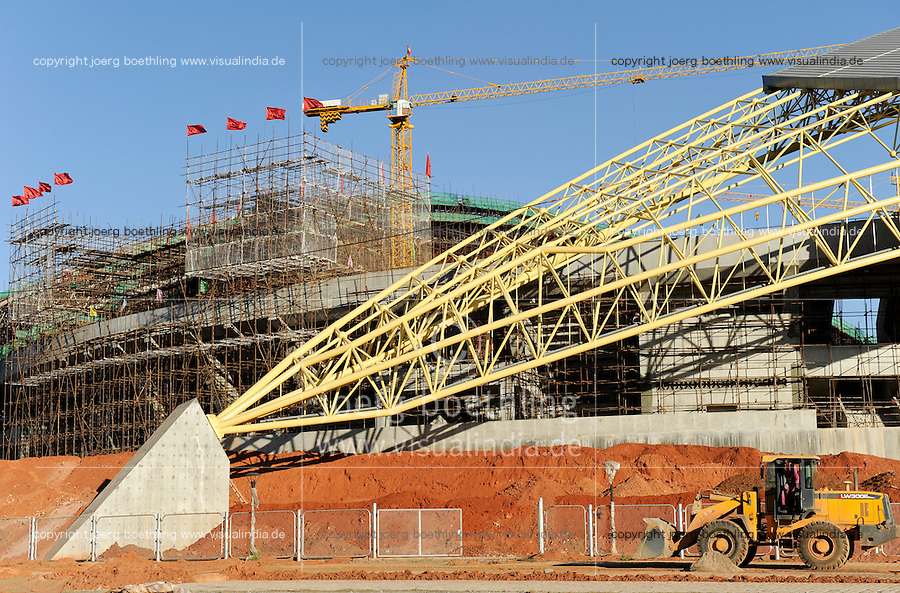 ZAMBIA Ndola , copperbelt, construction site of the Ndola National Stadium which is said to be financed by a concessional loan given to Zambia by China, constructed by the Chinese company Anhui Foreign Economic Construction Company (AFECC). close by Luanshya Copper Mines Plc in Luanshya is owned by a chinese undertaking / SAMBIA Ndola Copperbelt , chinesische Firma AFECC baut ein Fussballstadium in Ndola, Chinesen investieren massiv in rohstoffreichen Gebieten wie hier dem copperbelt , einem der groessten Kupferabbaugebiete weltweit,  die 20 km entfernte Kupfermine Luanshya Copper Mines Plc in Luanshya gehoert einem chinesischen Unternehmen
