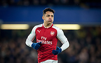 Alexis Sanchez of Arsenal puffs his cheeks during the Carabao Cup semi final 1st leg match between Chelsea and Arsenal at Stamford Bridge, London, England on 10 January 2018. Photo by Andy Rowland.