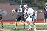La Canada Flintridge, CA 03/16/13 - Kyle Anderson (Coronado #19) and Brook Rideau (De La Salle #3) in action during the De La Salle vs Coronado lacrosse game at St Francis High School.  De La Salle defeated Coronado 8-5.
