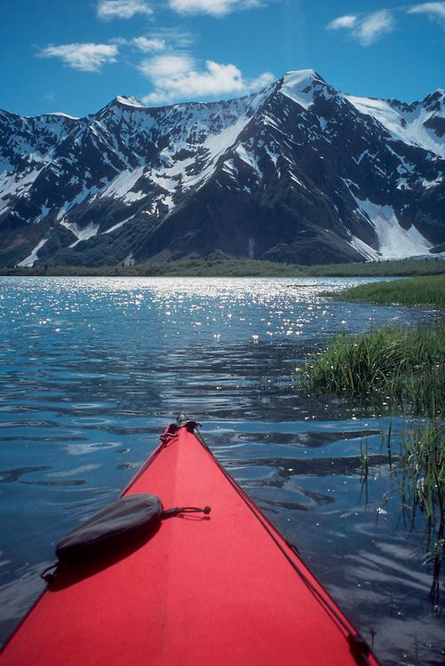 Kenai Fjords, Alaska: sea kayaker paddles through Aialik Bay, Kenai Fjords National Monument. Alaska, North America, USA.