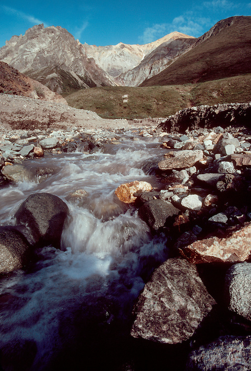 Alaska: Chugach Mountains, Cirque, Stream, Geology exposed: varied, striated rock and boulders litter a stream in the Alaska.