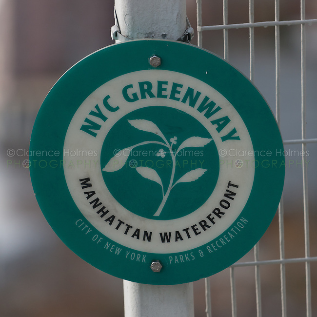 Sign designating the Manhattan Waterfront Greenway along the East River in Manhattan
