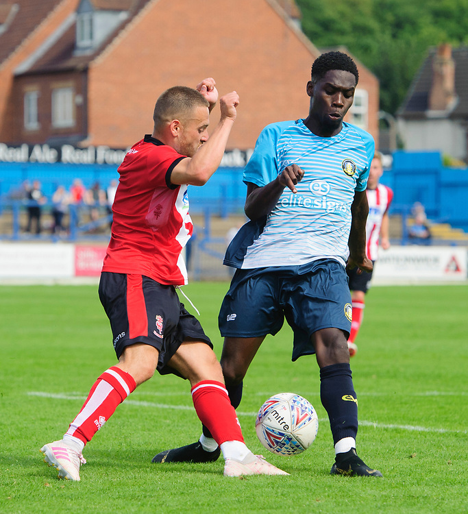 Lincoln City's Jack Payne vies for possession with Gainsborough Trinity's Rod Orlando Young<br /> <br /> Photographer Chris Vaughan/CameraSport<br /> <br /> Football Pre-Season Friendly (Community Festival of Lincolnshire) - Gainsborough Trinity v Lincoln City - Saturday 6th July 2019 - The Martin & Co Arena - Gainsborough<br /> <br /> World Copyright © 2018 CameraSport. All rights reserved. 43 Linden Ave. Countesthorpe. Leicester. England. LE8 5PG - Tel: +44 (0) 116 277 4147 - admin@camerasport.com - www.camerasport.com