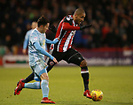 Leon Clarke of Sheffield Utd tackled by Bryan Oviedo of Sunderland during the Championship match at Bramall Lane Stadium, Sheffield. Picture date 26th December 2017. Picture credit should read: Simon Bellis/Sportimage