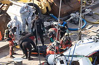 Rescue personnel recovers a body from the passenger boat Hableany (means Mermaid in Hungarian) lifted up from the river after it's capsize in an accident on river Danube in downtown Budapest, Hungary on June 11, 2019. ATTILA VOLGYI