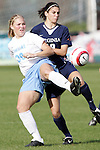 6 November 2005: North Carolina's Elizabeth Guess (left) plays the ball in front of Virginia's Alex Singer (right). The University of North Carolina defeated the University of Virginia 4-1 at SAS Stadium in Cary, North Carolina in theifinals of the 2005 ACC Women's Soccer Championship.