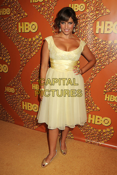 NOA TISHBY.HBO's 2010 67th Golden Globe Awards Post Party held at the Beverly Hilton Hotel, Beverly Hills, California, USA..January 17th, 2009.globes full length yellow dress hand on hip.CAP/ADM/BP.©Byron Purvis/Admedia/Capital Pictures