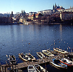 View of boats on River Vltava toward the castle, Prague, Czech Republic