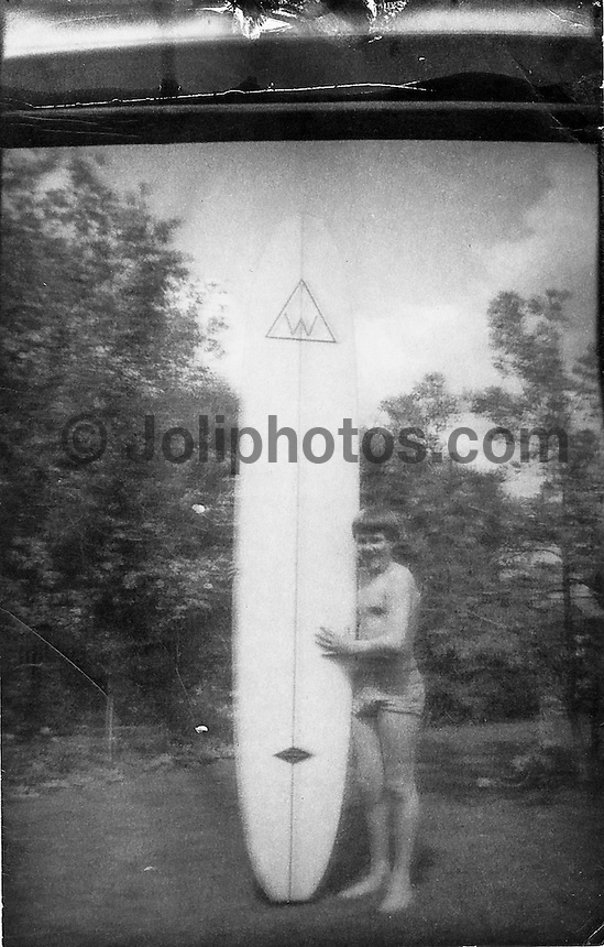 Peter Joli Wilson circa 1964. This si the very first photographic print I ever made. Taken by my Grandfather Warne Wilson of me holding my first surfboard, a Gordon Woods 9' 2&quot;  which I had partly saved up for and was co-purchased  fro my 14th birthday.<br /> I had laced a roll of black and white film, the image was shot then with the help of my grandfather we processed it and printed it. Photo: joliphotos.com