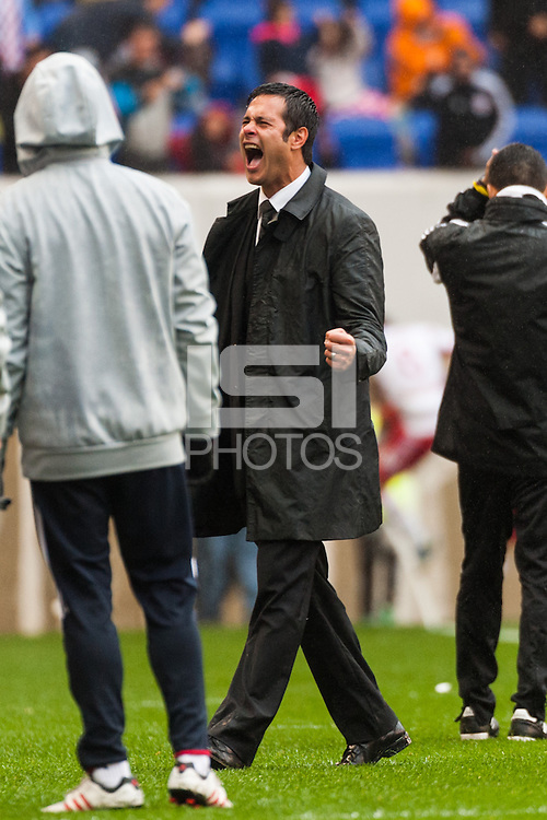 New York Red Bulls head coach Mike Petke celebrates the game winning goal. The New York Red Bulls defeated the Los Angeles Galaxy 1-0 during a Major League Soccer (MLS) match at Red Bull Arena in Harrison, NJ, on May 19, 2013.