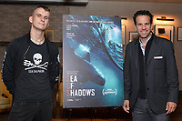 """NEW YORK - OCTOBER 30: (L-R) Jack Hutton and Carlos Loret de Mola attend the reception after the screening of National Geographic Documentary Films """"Sea of Shadows"""" and """"Lost and Found"""" on October 30, 2019 in New York City. (Photo by Anthony Behar/National Geographic/PictureGroup)"""
