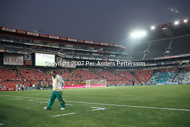 JOHANNESBURG, SOUTH AFRICA - SEPTEMBER 12: Coach Carlos Alberto Parreira walks frustrated on the side line as his team, the South African national team, plays badly during a friendly game against Uruguay on September 12, 2007 in Johannesburg, South Africa. The team, ranked 77 in the world, has had a history of bad performances and more than ten coaches since 1996. Carlos Alberto Parreira, the legendary Brazilian coach, now coaches them and he has the tough task of building up the team until 2010. Soccer is the most popular sport in South Africa, and because of the upcoming World Cup 2010 in South Africa the interest is increasing. For the first time the World Cup will be held on the African continent. (Photo by Per-Anders Pettersson).....
