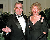 George Fisher, Chairman and CEO, Eastman Kodak Company, and his wife, Ann, arrive at The White House in Washington, DC for the State Dinner honoring Chinese President Jiang Zemin on October 29, 1997.<br /> Credit: Ron Sachs / CNP