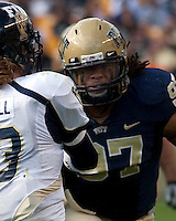 Pitt defensive end Jabaal Sheard (97) rushes the quarterback. The Pittsburgh Panthers defeated Florida International Golden Panthers 44-17 at Heinz Field, Pittsburgh Pennsylvania on October 2, 2010.