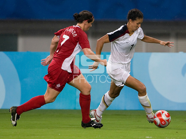 Diana Matheson, Shannon Boxx. The USWNT defeated Canada in extra time, 2-1, during the 2008 Beijing Olympics in Shanghai, China.