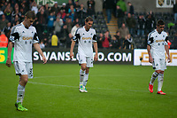 Saturday 17 August 2013<br /> <br /> Pictured: Ben Davies of Swansea and ?ngel Rangel of Swansea and Pablo Hern?ndez of Swansea<br /> <br /> Re: Barclays Premier League Swansea City v Manchester United at the Liberty Stadium, Swansea, Wales