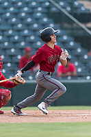AZL Diamondbacks left fielder Alek Thomas (5) follows through on his swing during an Arizona League game against the AZL Angels at Tempe Diablo Stadium on July 16, 2018 in Tempe, Arizona. The AZL Diamondbacks defeated the AZL Angels by a score of 4-3. (Zachary Lucy/Four Seam Images)