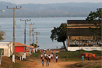 School children walk near an abandonded factory building in Fordlandia, a former factory town created by the Ford Motor Company on the banks of the Tapajós River, September 6, 2005. Deep in the Amazon forest, 12 hours by boat from the regional capital of Santarem in Brazil's Pará state, the rubber plantation and processing factory is now abandoned to the rain-forest, an aging memorial to American ideals and to the Brazilian reality. It almost seems like time has stopped in Fordlandia, or better yet, time has passed it by. In typical american style, it was organized and efficient, an idea admired by many Brazilians, and perhaps more so by residents of the untamed Amazon. But It is an idea hard to implement in the wilds of the amazon. Some might also say that it is also a typical American style the way Ford came here and tried to implement something with little knowledge of the local customs or terrain. From 1928 to 1945, Ford came tried to take control of his rubber supply, one of the most important products of the rainforest. After only 17 years the company admitted defeat and retreated from the forest.