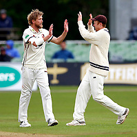 Calum Haggett (L) enjoys a high five with Adam Riley after taking the wicket of Babar Azam during day 1 of the four day tour match between Kent CCC and Pakistan at the St Lawrence Ground, Canterbury, on Sat April 28, 2018