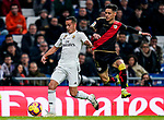Lucas Vazquez of Real Madrid (L) is tackled by Adrian Embarba Blazquez of Rayo Vallecano during the La Liga 2018-19 match between Real Madrid and Rayo Vallencano at Estadio Santiago Bernabeu on December 15 2018 in Madrid, Spain. Photo by Diego Souto / Power Sport Images