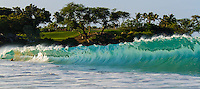 A bodysurfer takes a picture in the barrel of a wave at Kauna'oa Bay near Mauna Kea Hotel, Big Island.