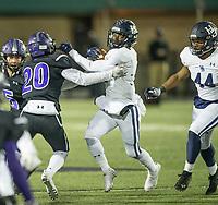 NWA Democrat-Gazette/BEN GOFF @NWABENGOFF<br /> Jay Burns, Springdale Har-Ber running back, breaks the tackle of Aidan Garrison (20), Fayetteville defender, in the third quarter Friday, Nov. 8, 2019, at Harmon Stadium in Fayetteville.