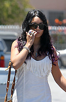 Happy family: Vanessa Hudgens seen going to church with boyfriend_Austin_Butler and his_mom in Studio City on Sunday. Vanessa wore a tassled maxi dress and a brown suede bag. Los Angeles, California on 24.06.2012. NOTICE: Vanessa is biting her finger nails..Credit: Correa/face to face.. /MediaPunch Inc. ***FOR USA ONLY*** ***Online Only for USA Weekly Print Magazines*** *NORTEPHOTO*<br />