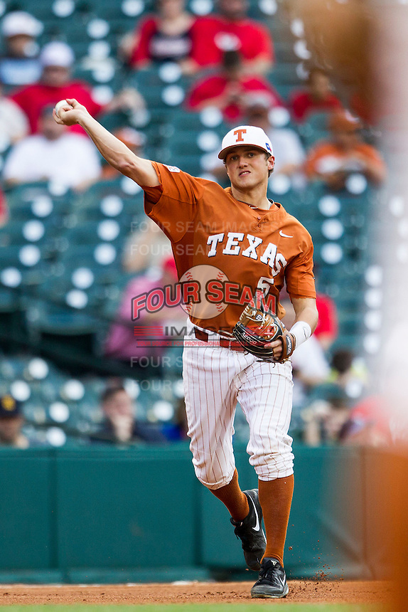 Texas Longhorns third baseman Andy McGuire #5 makes a throw to first base during the NCAA baseball game against the Houston Cougars on March 1, 2014 during the Houston College Classic at Minute Maid Park in Houston, Texas. The Longhorns defeated the Cougars 3-2. (Andrew Woolley/Four Seam Images)