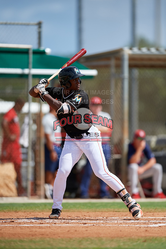 GCL Marlins shortstop Osiris Johnson (9) at bat during a game against the GCL Cardinals on August 4, 2018 at Roger Dean Chevrolet Stadium in Jupiter, Florida.  GCL Marlins defeated GCL Cardinals 6-3.  (Mike Janes/Four Seam Images)
