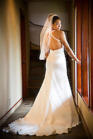 A beautiful bride poses in her wedding dress, Hau'ula, O'ahu.