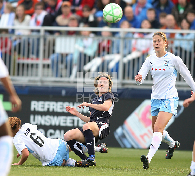 Sonia Bompastor of the Washington Freedom sends over a cross between Brittany Klein and Marion Dalmy of the Chicago Red Stars during a WPS match at Maryland Soccerplex on April 11 2009, in Boyd's, Maryland.  The game ended in a 1-1 tie.