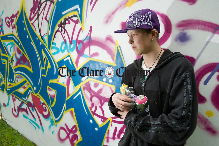 Graffiti artist Dylan Dickerton with his work of art at the Iniscealtra Festival of Arts at Mountshannon. Photograph by John Kelly.