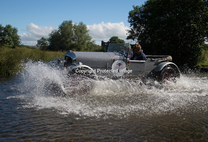 14/06/16<br /> <br /> Sue Shoosmith and Trina Harley in a 1926 Bentley 3/ 4 1/2 Litre.<br /> <br /> Competitors in the Royal Automobile Club 1000 Mile Trial splash through Tissington Ford near Ashbourne in the Derbyshire Peak District. The rally saw 43 pre-war cars leave Edinburgh on Monday and finishes in Dorking, Surrey on Saturday.<br /> All Rights Reserved, F Stop Press Ltd.