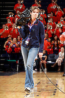 CHARLOTTESVILLE, VA- NOVEMBER 26:  A camera woman films during the game on November 26, 2011 at the John Paul Jones Arena in Charlottesville, Virginia. Virginia defeated Green Bay 68-42. (Photo by Andrew Shurtleff/Getty Images) *** Local Caption ***