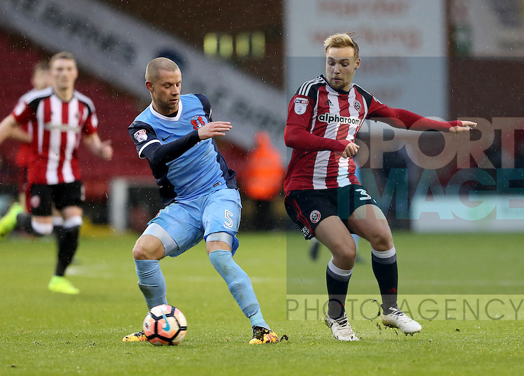 Harry Chapman of Sheffield United challenges Alan Dunne of Leyton Orient during the Emirates FA Cup Round One match at Bramall Lane Stadium, Sheffield. Picture date: November 6th, 2016. Pic Simon Bellis/Sportimage
