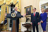 United States President Donald Trump speaks alongside Steven Munchin and his fiancee Louise Linton, before Munchin was sworn-in as Treasury Secretary, during a ceremony at the White House in Washington, D.C. on February 13, 2017. Mnuchin was confirmed by the Senate 54-47 earlier today. <br /> Credit: Kevin Dietsch / Pool via CNP