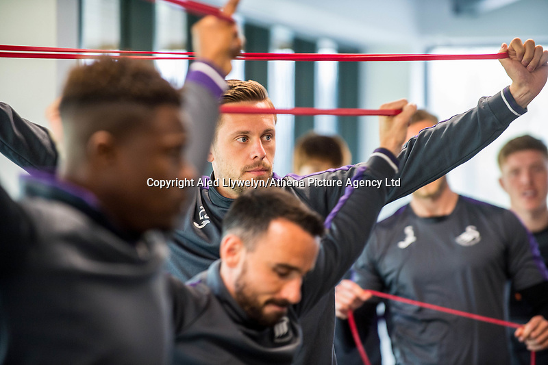Thursday  20 April 2017<br /> Pictured L-R: Luciano Narsingh, Gylfi Sigurdsson and Leon Britton work out in the gymnasium  <br /> Re: Swansea City FC training session at the Fairwood training ground, Swansea, Wales, UK