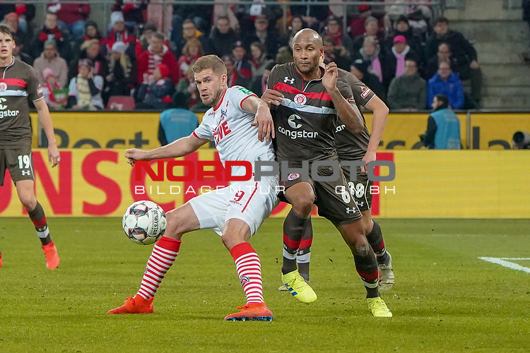 08.02.2019, RheinEnergieStadion, Koeln, GER, 2. FBL, 1.FC Koeln vs. FC St. Pauli,<br />  <br /> DFL regulations prohibit any use of photographs as image sequences and/or quasi-video<br /> <br /> im Bild / picture shows: <br /> Simon Terodde (FC Koeln #9), erkaempft sich gegen Christopher Avevor (St Pauli #6),  gerade den Ball fuer sein Tor <br /> <br /> Foto &copy; nordphoto / Meuter
