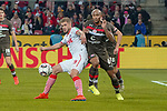 08.02.2019, RheinEnergieStadion, Koeln, GER, 2. FBL, 1.FC Koeln vs. FC St. Pauli,<br />  <br /> DFL regulations prohibit any use of photographs as image sequences and/or quasi-video<br /> <br /> im Bild / picture shows: <br /> Simon Terodde (FC Koeln #9), erkaempft sich gegen Christopher Avevor (St Pauli #6),  gerade den Ball fuer sein Tor <br /> <br /> Foto © nordphoto / Meuter