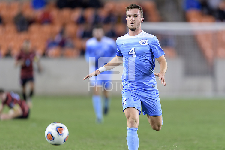 Houston, TX - Friday December 9, 2016: Alex Comsia (4) of the North Carolina Tar Heels chases after a loose ball against the Stanford Cardinal at the NCAA Men's Soccer Semifinals at BBVA Compass Stadium in Houston Texas.