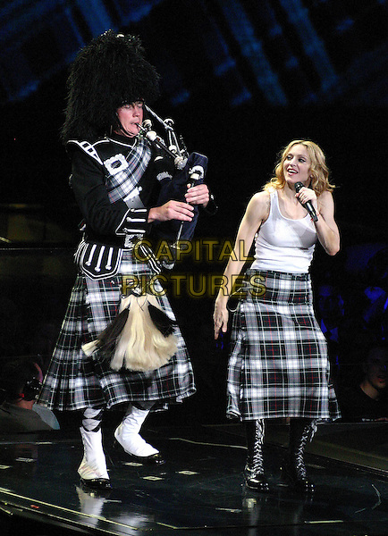 "MADONNA.On her ""Re-Invention"" tour performs live in concert at Madison Square Garden, New York,USA,.23rd June 2004..full length gig music on stage kilt  white vest bagpipes tartan.www.capitalpictures.com.sales@capitalpictures.com.©Capital Pictures"