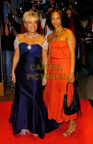 DENISE WELCH & ANGELA GRIFFIN.TV Quick & TV Choice Awards arrivals at the Dorchester Hotel, London, UK..September 4th, 2006.Ref: CAN.full length blue orange strapless dress black bag purse brooch.www.capitalpictures.com.sales@capitalpictures.com.©Can Nguyen/Capital Pictures
